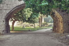 Road through the arc. Dusty road trough the arc in ancient city. Toned photo Stock Photos