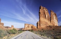 Road through Arches National Park. On the road past Courthouse Towers in Arches National Park in southern Utah Stock Photo
