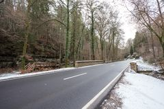 Road in the Ardennes. In the Ardennes in the forest this road runs in the snow Stock Photography