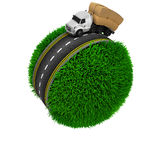Road around a grassy globe Stock Photo