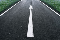 Road arrow direction sign. On the asphalt ground Royalty Free Stock Image