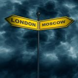 Road arrow sign. 3d rendering of road signs with London and Moscow text pointing in opposite directions. Image relative to politic situation between Great Stock Photos
