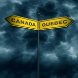 Road arrow sign. 3d rendering of road signs with Canada and Quebec text pointing in opposite directions. Image relative to politic situation between Canada and Stock Photo