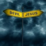 Road arrow sign. 3d rendering of road signs with DEVIL and JESUS text pointing in opposite directions Stock Photos