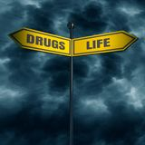 Road arrow sign. 3d rendering of road signs with DRUGS and LIFE text pointing in opposite directions Stock Photos