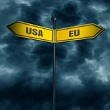 Road arrow sign. 3d rendering of road signs with USA and EU text pointing in opposite directions. Image relative to politic situation between USA and European Royalty Free Stock Image
