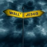 Road arrow sign. 3d rendering of road signs with WALL STREET and JESUS text pointing in opposite directions Royalty Free Stock Photo