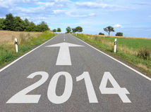 Road with arrow to year 2014 Stock Images