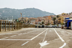Road with arrows on the pavement. Boat, dock, car ride, mountain Royalty Free Stock Photo