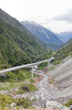 Road in Arthur pass and high mountains, South island, New Zealand Stock Photos