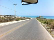 driving on the road next to the Caribbean Sea with  its blue colors Royalty Free Stock Photos