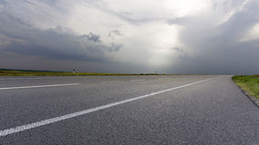 Road. Asphalt Road in the evening feld Stock Photography