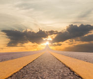 Road asphalt suspended to sunset. Road asphalt suspended to the sky over sunset Royalty Free Stock Image