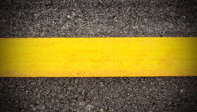 Road asphalt texture and background with yellow line Stock Photo