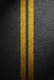 Road asphalt texture with separation lines.  Royalty Free Stock Photography