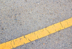 Road asphalt texture and yellow line Royalty Free Stock Photo