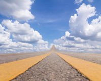 Road asphalt to the sky over the clouds Royalty Free Stock Photo