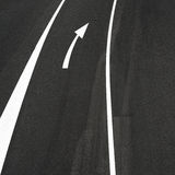 Road asphalt, white lines and right arrow sign Royalty Free Stock Photos