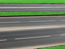 Road  asphalted  highway. The multistrip asphalted road with a dividing lawn Stock Photos