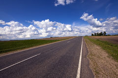 The road. The asphalted road, in rural areas. Belarus Royalty Free Stock Photos