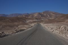 Road through the Atacama Desert in northern Chile. Road through the Atacama Desert from Arica on the coast to the small town of Putre on the Altiplano of Stock Photos