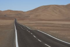 Road through the Atacama Desert in northern Chile. Road through the Atacama Desert to the historic coastal town of Pisagua in the Tarapaca Region of northern Royalty Free Stock Image