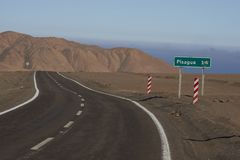 Road through the Atacama Desert in northern Chile. Road through the Atacama Desert to the historic coastal town of Pisagua in the Tarapaca Region of northern Stock Photo