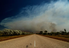 Road of Australia, bush fire. Road of Australia with huge bush fire in background, smoke and blue sky stock photography