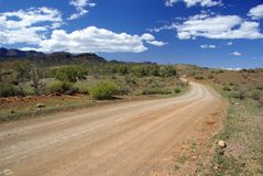 Road in Australian outback. Dusty road receding through Moralana Scenic Drive, Flinders Ranges National Park, Southern Australia Stock Photos