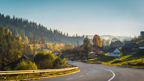 Road and autumn forest and countryside. Road and autumn forest and countryside Stock Photos