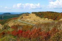 Road in autumn mountain. The Mountain  pass Kholmskiy on island Sakhalin by autumn Royalty Free Stock Photography