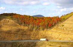 Road in autumn mountain. The Mountain  pass Kholmskiy on island Sakhalin by autumn Stock Photography