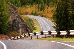 Road in autumn mountains Stock Photography