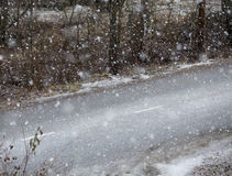 Road and awful weather. Snow blizzard. Snow blizzard and empty asphalt road. Focus point on the white mark between the lanes. Awful weather to drive. Winter day stock photography
