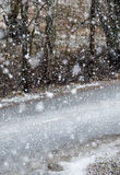Road and awful weather. Snow blizzard. Snow blizzard and empty asphalt road. Focus point on the white mark between the lanes. Awful weather to drive. Winter day stock image