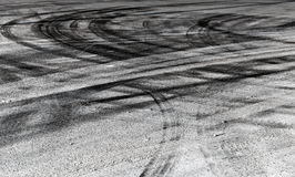 Road background with crossing of tires tracks Royalty Free Stock Photos