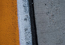 Road background with crossing of yellow white road marking and tires track Stock Images