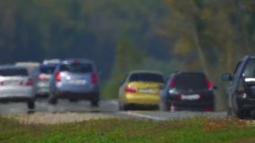 Track. The movement of vehicle on a road. Car traffic. Highway in summer day. Cars on a country road. Cars moving in two. Road the background of traffic stream stock video