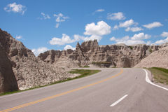 Road Through the Badlands. A road curving through the Badlands of South Dakota royalty free stock photo