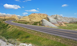 Road through the Badlands. Highway 240 courses through the Yellow Mounds area of Badlands National Park, South Dakota Stock Images