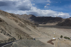 A road in barren mountain terrain of Ladakh taken from a monastery. stock images