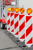 Road barrier. With amber beacon flashing lights Stock Images