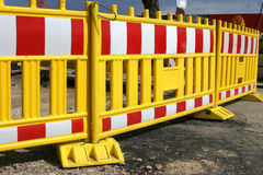 Road barrier. Surrounding the area of some roadworks in the city royalty free stock image