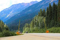 Road barriers on a mountainous road in summer.  royalty free stock image