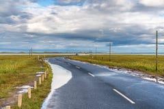 Road between Beal and Holy Island, Northumberland, England, UK royalty free stock image