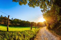 Road through a beautiful autumn landscape stock photography