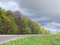 Road and beautiful cloudy sky, Lithuania Royalty Free Stock Photo