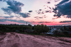 Road and beautiful evening sky at sunset in the country Stock Photography
