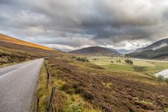 Road through beautiful landscape of cairngorms national park in Stock Photo