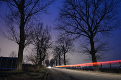 The road. A beautiful sky..and nice trees Royalty Free Stock Images